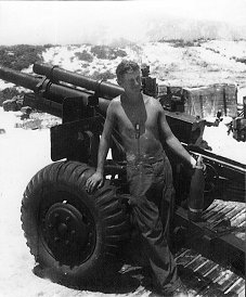 Section chief Mike McGowan pictured infront of his gun in Vietnam
